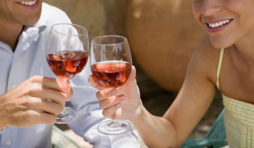 couple toasting with wine during wine lovers weekend at Chatham Gables Inn in Cape Cod