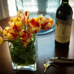 bedside flowers and wine