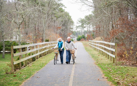mature couple exploring the cape cod rail trail, one of the best things to do in cape cod near chatham, massachusetts