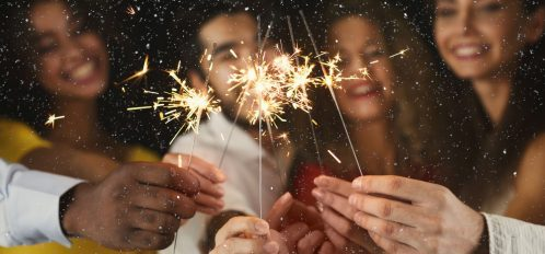 Friends Lighting Sparklers for Cape Cod New Years