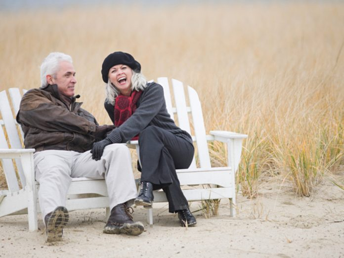 Mature Couple Sitting on Beach Chairs During Winter in Cape Cod