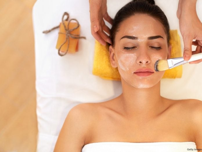 Face Treatment. Woman in Cape Cod spa and gets Marine Mask