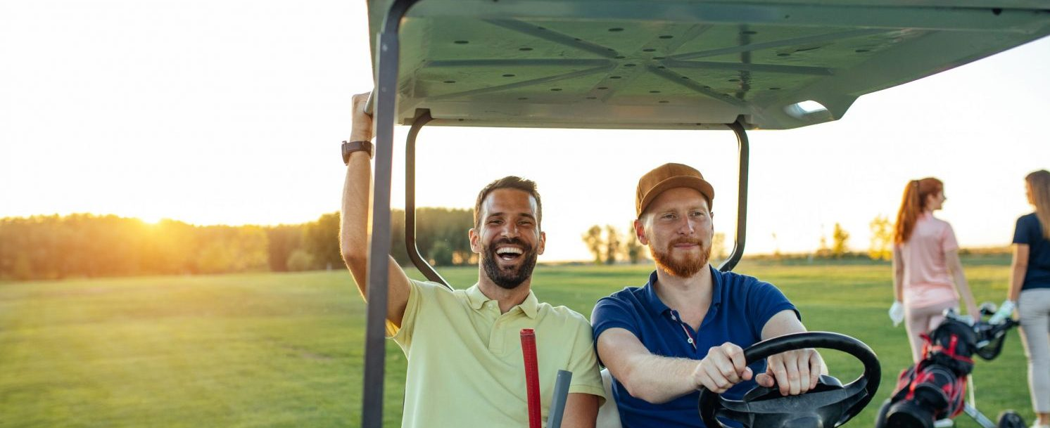 Guys golfing during their guys weekend to cape cod